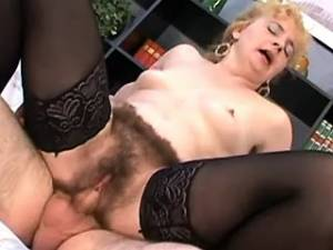 Lewd mature in stockings gets cum on hairy pussy