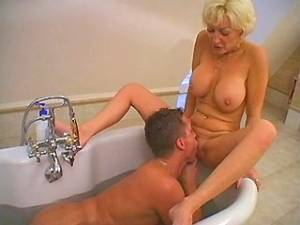 Chesty blonde mature gets mouthful by amateur guy