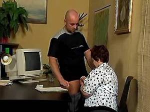 Naughty old secretary sucks fresh cock in office