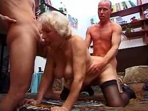Lustful grandma in stockings gets cum in group