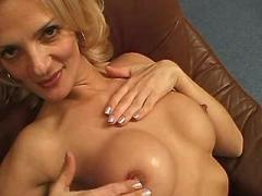 Perky mature lady dildoing on chair