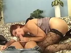 Mature in stockings drilled on sofa
