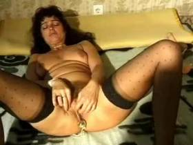 Horny milf stuffs pussy by sex toys