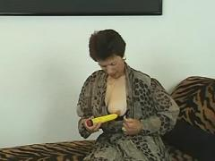 Hot granny dildoing herself on sofa