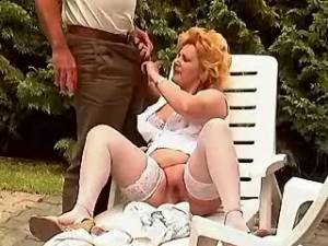 Golden haired lady sucking outdoor