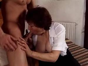 Dark haired grandma drilled on sofa