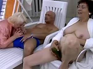 Two old fatties share man near pool
