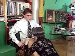 Aged secretary takes in mouth and ass