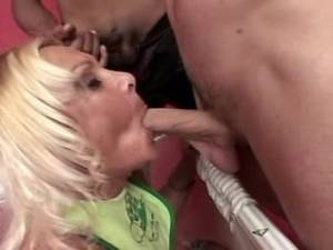Plump granny sucks fresh cocks by turns in orgy