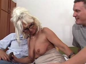 Granny in stockings has fun with amateur guys