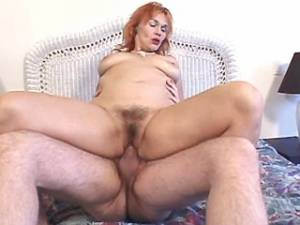 Redhead mature with hairy pussy rides strong cock