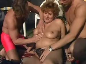 Plump granny spoils amateur guys in orgy outdoor