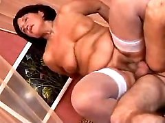 Grandma in stockings fucks in hotel