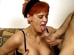 Redhead mom in stockings going wild