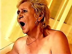 Granny throats cock and rides him
