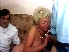 Kinky granny sucks hard cock of guy