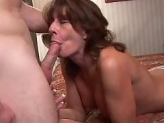 Sexy milf with pierced tits sucking