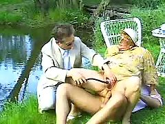 Hot granny gets cum outdoor in orgy