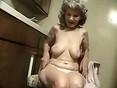 Lonely old woman dildoing herself